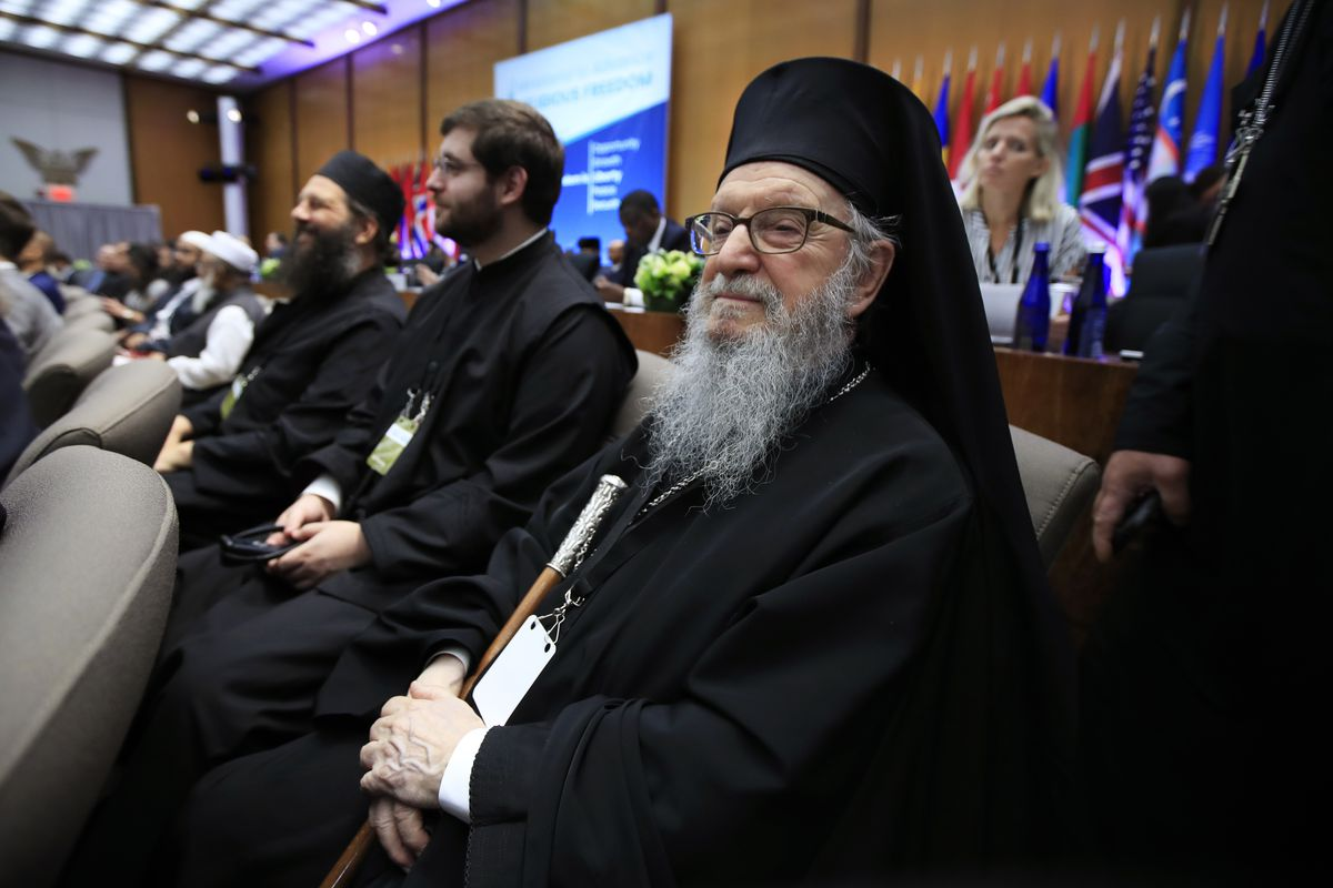 Archbishop Demetrios of America, right, from Greek Orthodox Archdiocese, attends the first-ever Ministerial to Advance Religious Freedom at the State Department in Washington, Thursday, July 26, 2018, attended by Vice President Mike Pence and hosted by Se