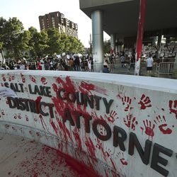 Protesters decrying the police shooting of Bernardo Palacios-Carbajal painted and marked the district attorney's office in Salt Lake City on Thursday, July 9, 2020.