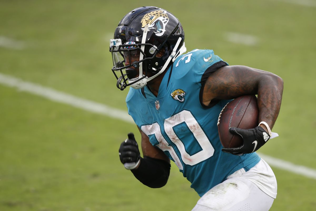 Jacksonville Jaguars running back James Robinson (30) runs for a touchdown against the Detroit Lions during the second half at TIAA Bank Field.
