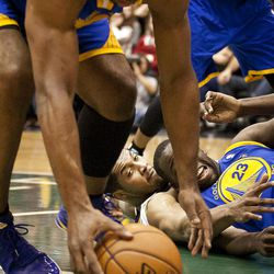 Jazz forward Derrick Favors (15) looks on as Warriors forward Carl Landry (7), left, picks up a loose ball during the first half of the NBA basketball game between the Utah Jazz and the Golden State Warriors at Energy Solutions Arena, Wednesday, Dec. 26, 2012.