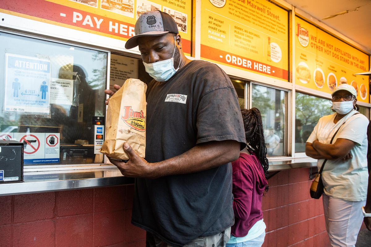 Shawn Atwood picks up his order at Jim'sOriginal in the University Village neighborhood, Friday afternoon, Sept. 3, 2021. Once open 24 hours, Jim's changed its hours and will be closed from 1 a.m. to 6 a.m.
