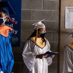 Abhinav Goel, Valedictorian, Cindy Mei, Salutatorian, and Maddie Pieper, Senior Class Vice-President, prepare for their graduation speeches.