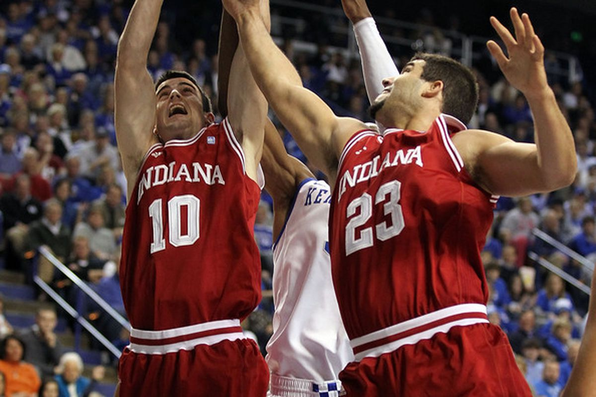 LEXINGTON KY - DECEMBER 11: Will Sheehey#10 and Bobby Capobianco #23 of the Indiana Hoosiers reach for a rebound during the game against the Kentucky Wildcats on December 11 2010 in Lexington Kentucky.  (Photo by Andy Lyons/Getty Images)
