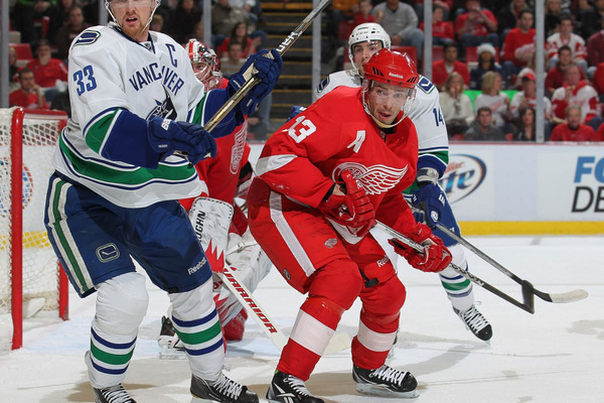DETROIT MI - DECEMBER 22:  Henrik Sedin #33 of the Vancouver Canucks skates against Pavel Datsyuk #13 of the Detroit Red Wings in a game on December 22 2010 at the Joe Louis Arena in Detroit Michigan. (Photo by Claus Andersen/Getty Images)