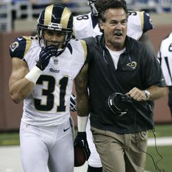 St. Louis Rams defensive back Cortland Finnegan (31) celebrates his interception and 31-yard return for a touchdown with coach Jeff Fisher in the second quarter of an NFL football game against the Detroit Lions, Sunday, Sept. 9, 2012, in Detroit.
