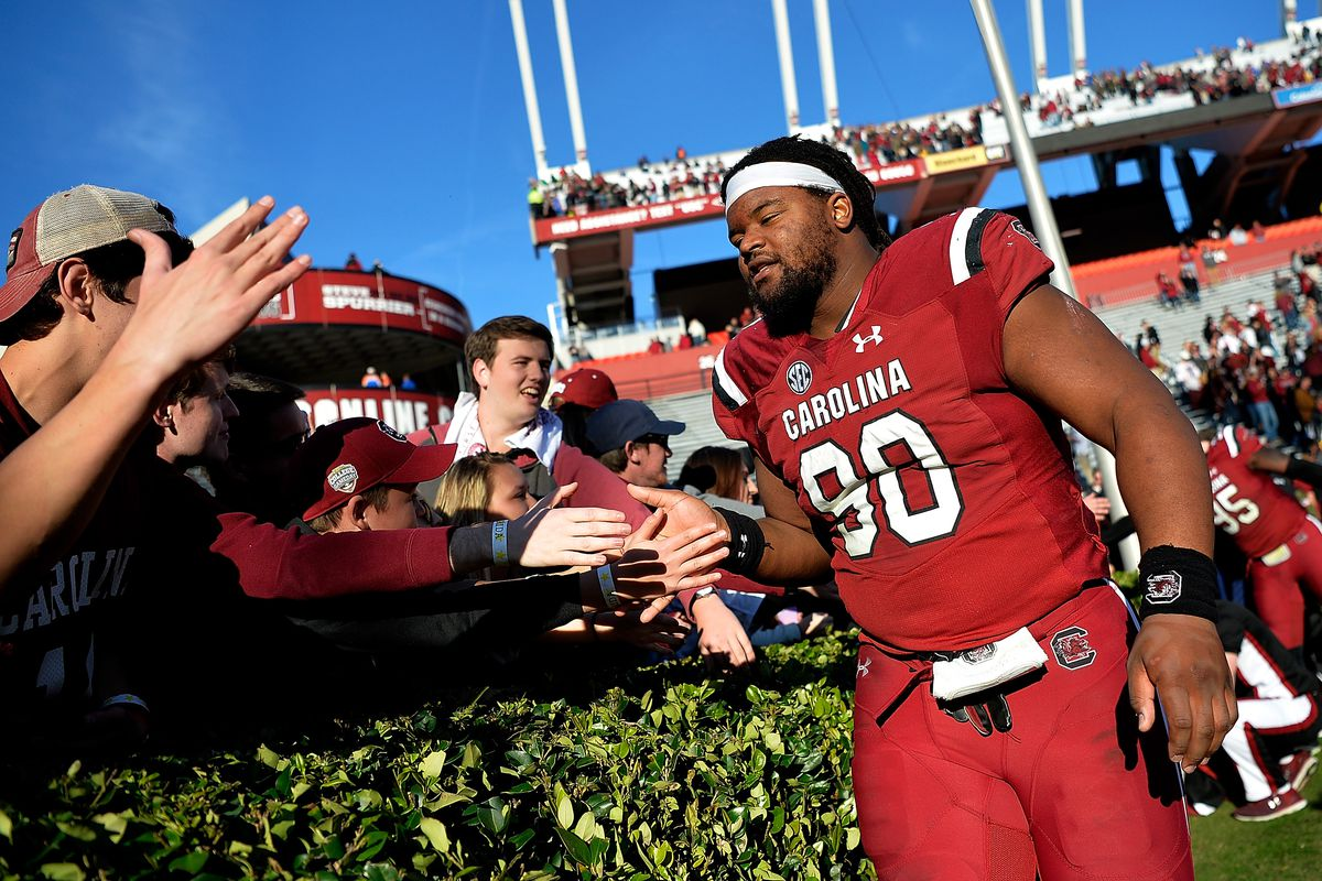 COLUMBIA, SC - NOVEMBER 11:  Taylor Stallworth #90 of the South Carolina Gamecocks high-fives fans after their game against the Florida Gators at Williams-Brice Stadium on November 11, 2017 in Columbia, South Carolina. South Carolina won 28-20.  (Photo by Grant Halverson/Getty Images)