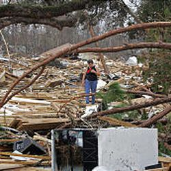 A resident of Waveland, Miss., searches Thursday through debris of houses destroyed by Hurricane Katrina.