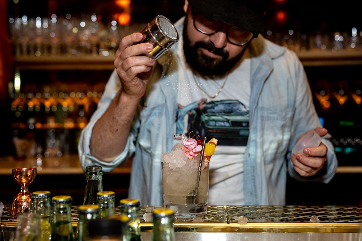 Bartender Sam Ross making a drink at Young Blood in San Diego