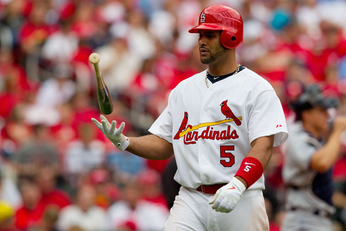 ST. LOUIS, MO - APRIL 2: Albert Pujols #5 of the St. Louis Cardinals returns to the dugout after striking out against the San Diego Padres at Busch Stadium on April 2, 2011 in St. Louis, Missouri.  (Photo by Dilip Vishwanat/Getty Images)