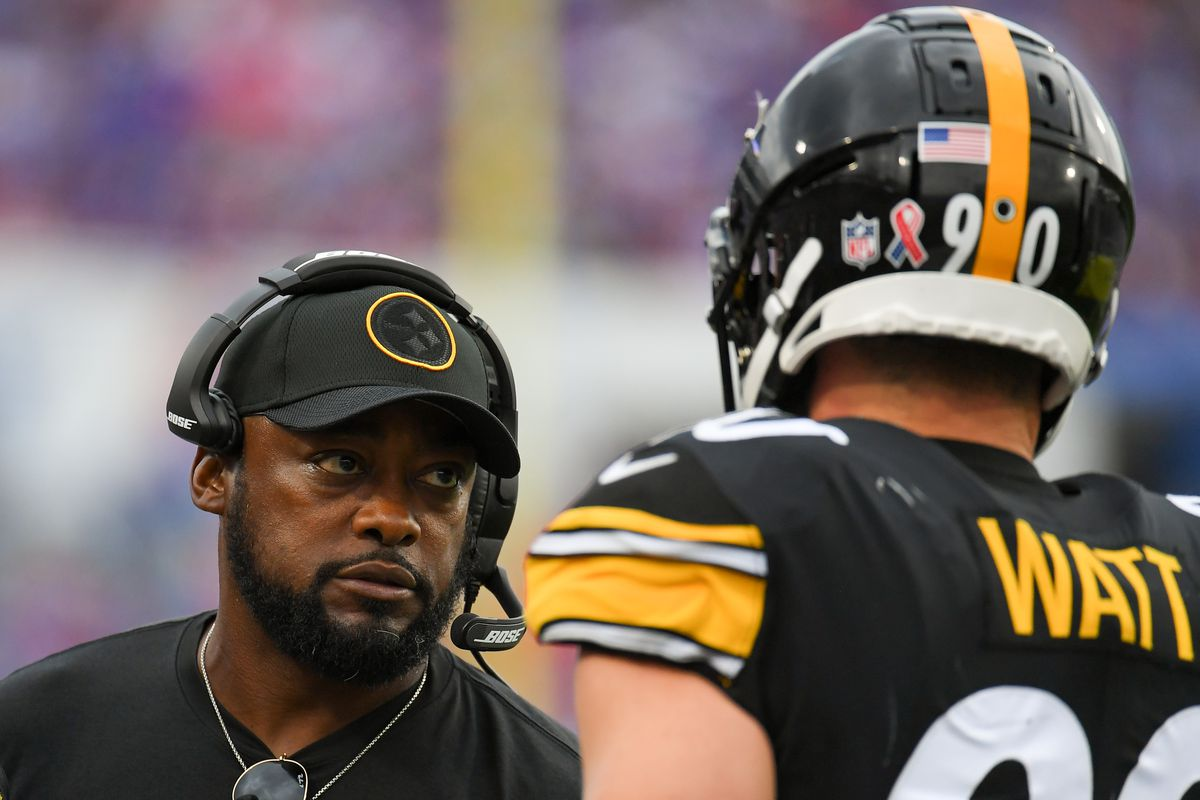 Pittsburgh Steelers head coach Mike Tomlin talks with outside linebacker T.J. Watt (90) against the Buffalo Bills during the second half at Highmark Stadium