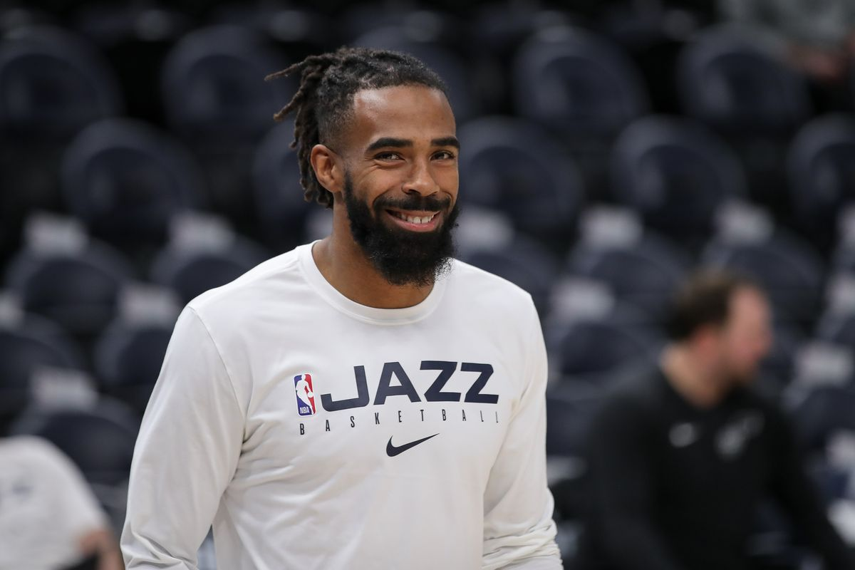 Utah Jazz guard Mike Conley smiles as he walks onto the court before a game against the Golden State Warriors at Vivint Smart Home Arena.