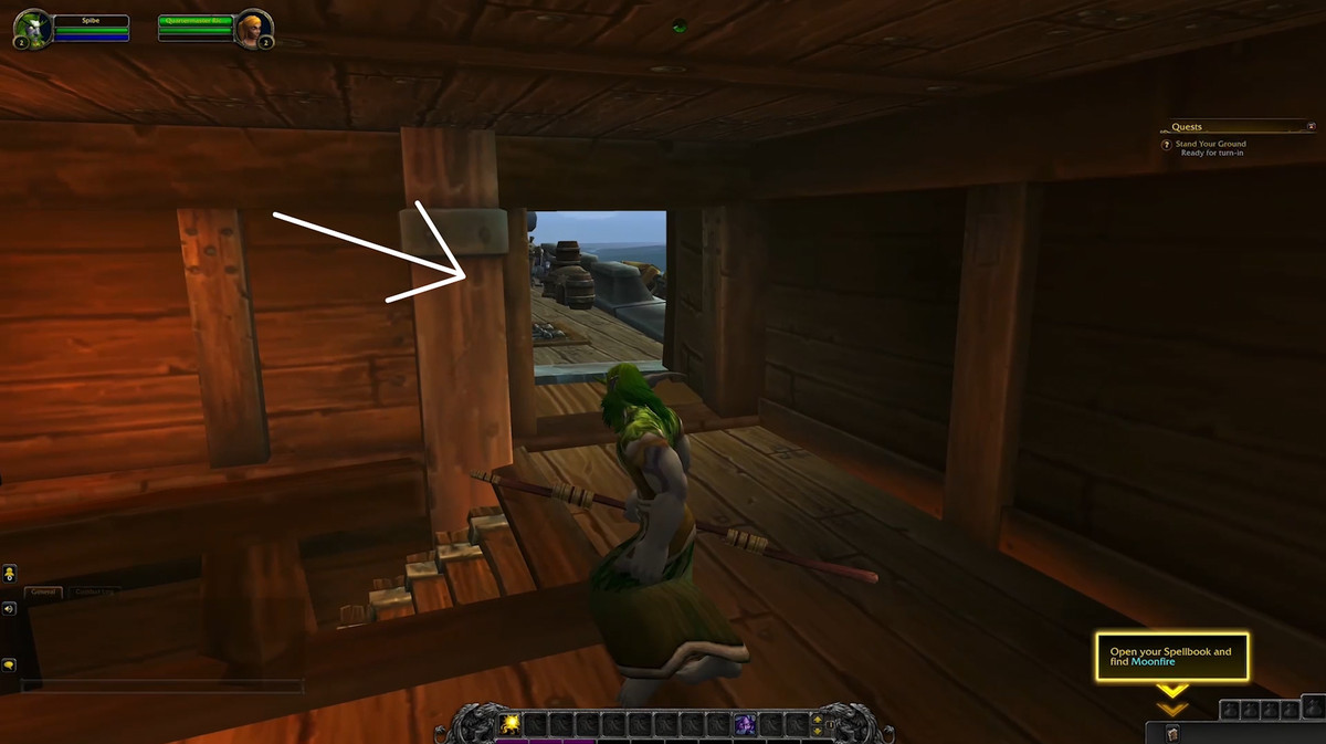 A player-controlled druid is on a wooden ship, looking out of an opening that is door-shaped but does not have a door.