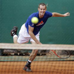 Andy Murray of Great Britain returns the ball during a training session of the Monte Carlo Tennis Masters tournament in Monaco, Sunday, April 15, 2012.