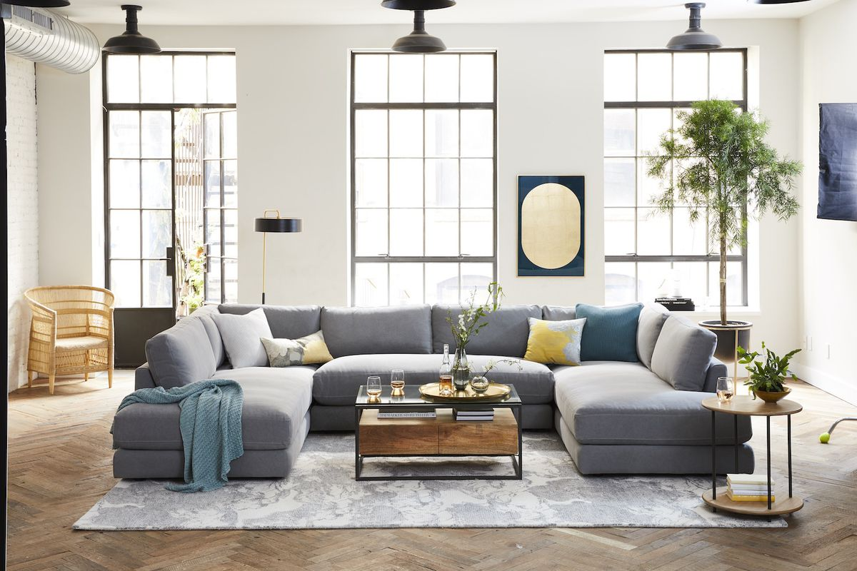Living room with gray couch and teal blanket