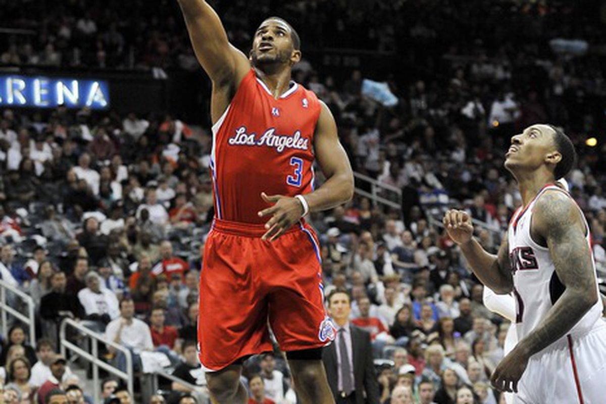 Apr 22, 2012; Atlanta, GA, USA; Los Angeles Clippers point guard Chris Paul (3) drives to the basket against Atlanta Hawks point guard Jeff Teague (0) during the first half at Philips Arena. Mandatory Credit: Paul Abell-US PRESSWIRE
