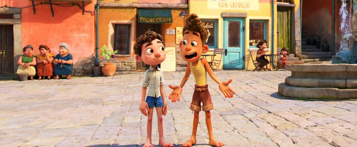 Two cartoon boys stand in a town square.