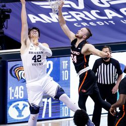 Brigham Young Cougars center Richard Harward (42) puts the ball in ahead of Pacific Tigers guard Broc Finstuen (24) during the first overtime at the Marriott Center in Provo on Saturday, Jan. 30, 2021.