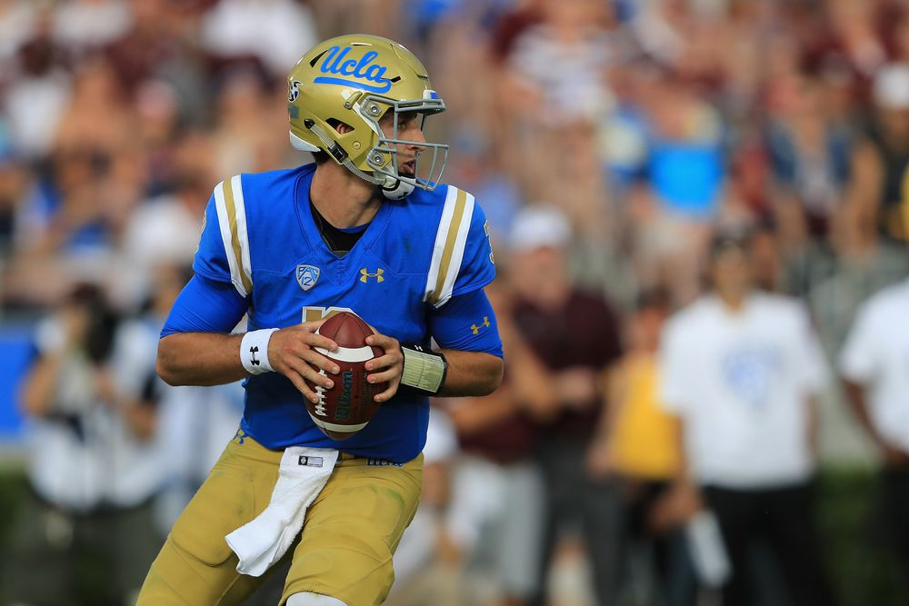PASADENA, CA:  UCLA Bruins quarterback Josh Rosen (3) looks to throw against the Texas A&M Aggies defense at the Rose Bowl.