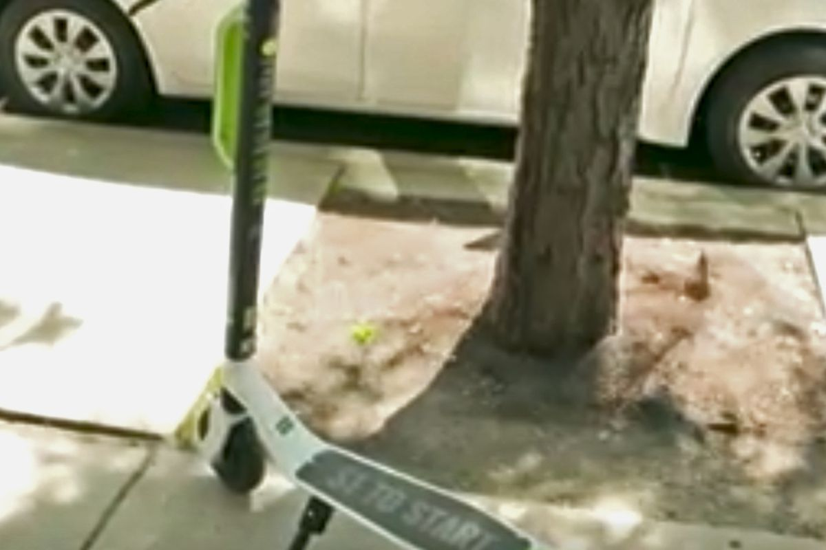 Dockless electric scooter outside on the sidewalk