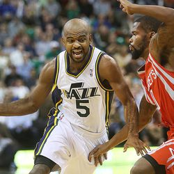 Utah Jazz's point guard John Lucas III (5) drives on Houston's Aaron Brooks as the Jazz and the Rockets play Saturday, Nov. 2, 2013 in EnergySolutions arena. Jazz lost 104-93.