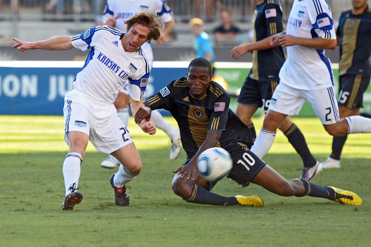 CHESTER PA - SEPTEMBER 04: Jonathan Leathers #25 of the Kansas City Wizards and Danny Mwanga #10 of the Philadelphia Union fight for the ball at PPL Park on September 4 2010 in Chester Pennsylvania.  (Photo by Drew Hallowell/Getty Images)