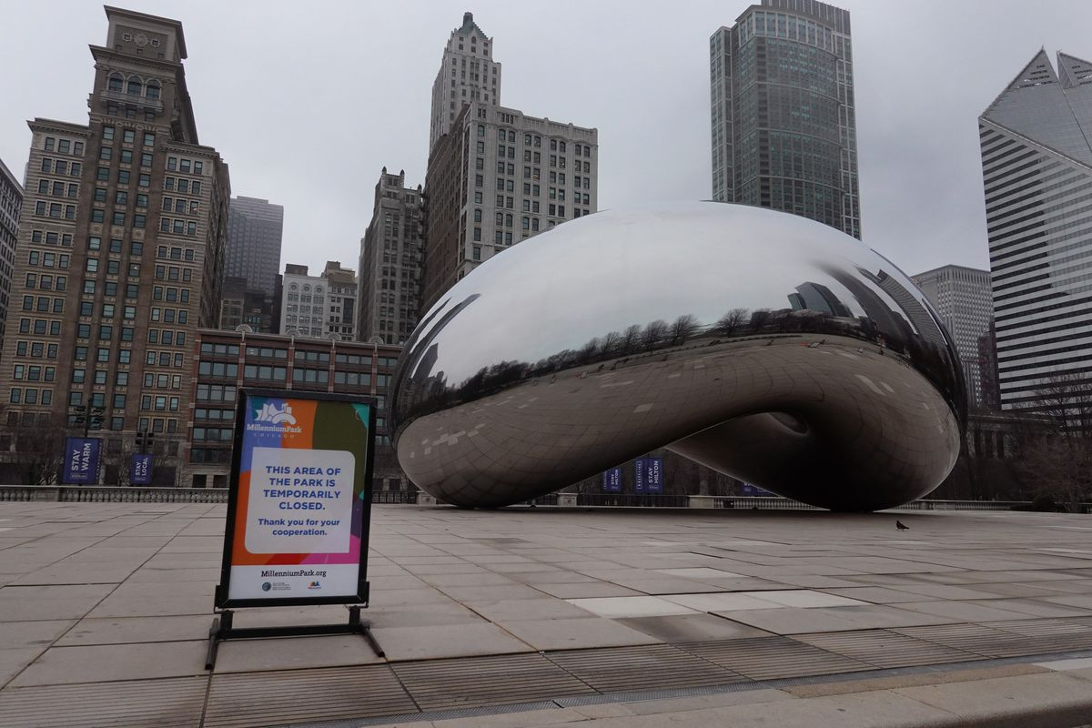 The area around the Bean sits empty in Millennium Park due to efforts to control the spread of COVID-19.