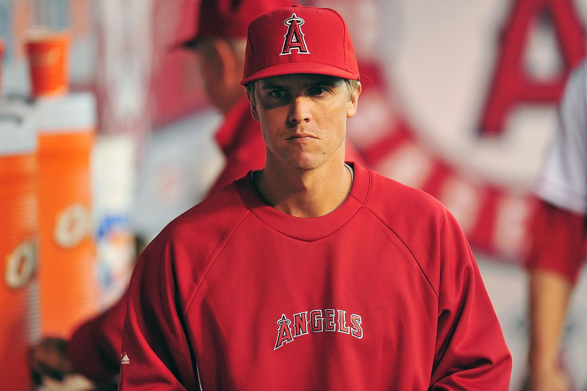 July 28, 2012; Anaheim, CA, USA; Los Angeles Angels pitcher Zack Greinke watches game action during the fourth inning against the Tampa Bay Rays at Angel Stadium. Mandatory Credit: Gary A. Vasquez-US PRESSWIRE