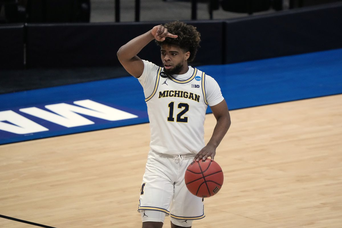 Michigan Wolverines guard Mike Smith (12) brings the ball upcourt against the Texas Southern Tigers during the first half in the first round of the 2021 NCAA Tournament at Mackey Arena.