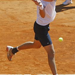 U.S. player John Isner returns the ball to French tennis player Jo-Wilfried Tsonga , during their match, in the quarterfinal of the Davis Cup between France and U.S. in Monaco Sunday April 8, 2012. (AP Photo/Remy de la Mauviniere)
