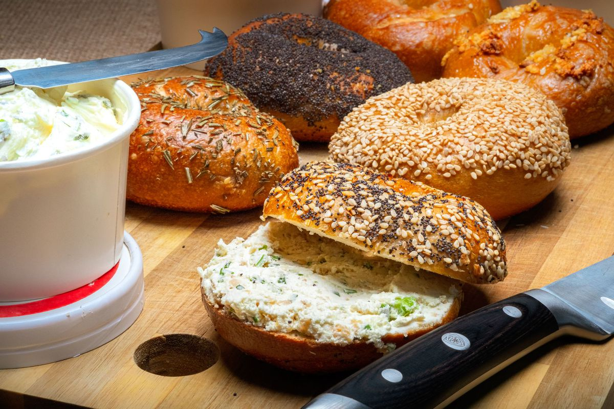 A selection of offerings from Rubinstein Bagels, including an everything variety smeared with cream cheese