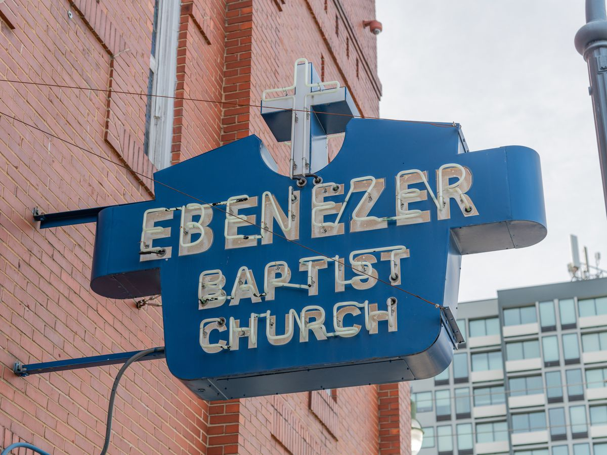 Blue sign with white letters that read Ebenezer Baptist Church