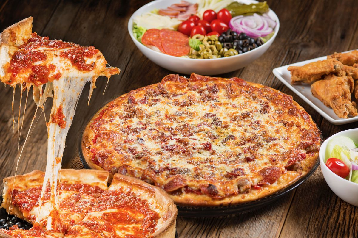 A table full of pizzas.