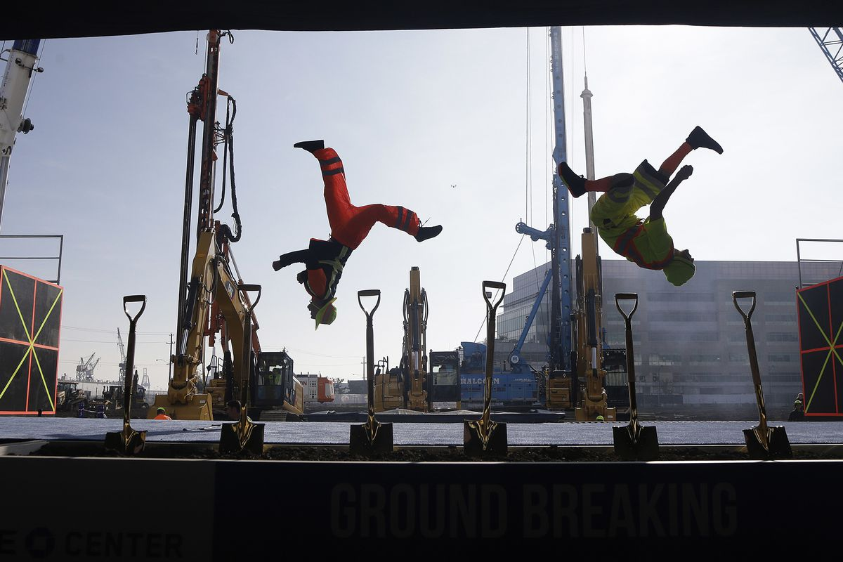 A group performs during a ground breaking ceremony for the Golden State Warriors' new arena.