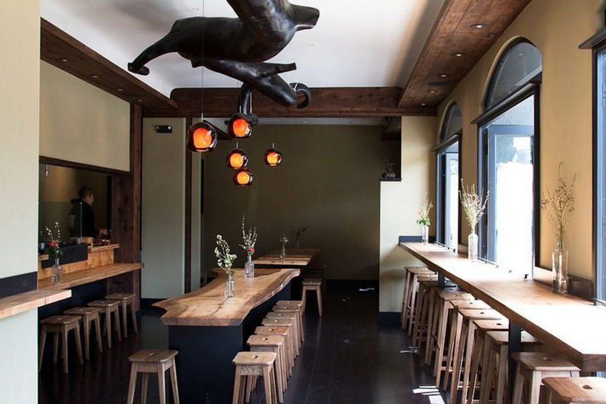 The shadowy dark area in back is an extra dining area that can be sectioned off for private parties.