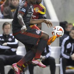 Real Salt Lake forward Olmes Garcia (13) and Toronto FC defender Doneil Henry (15) both go for the ball during a game at Rio Tinto Stadium in Sandy on Saturday, March 29, 2014.
