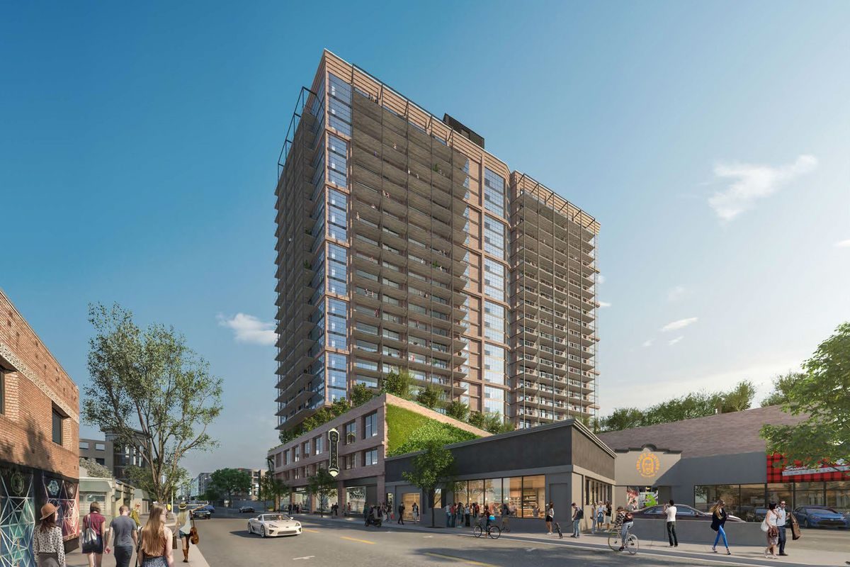 The rendering shows a tall building with balconies and a podium on the lower floors.