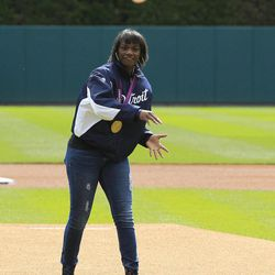 Olympic gold medal boxer Claressa Shields throws out a ceremonial first pitch before a baseball game between the Detroit Tigers and the Minnesota Twins at Comerica Park in Detroit, Sunday, Sept. 23, 2012.