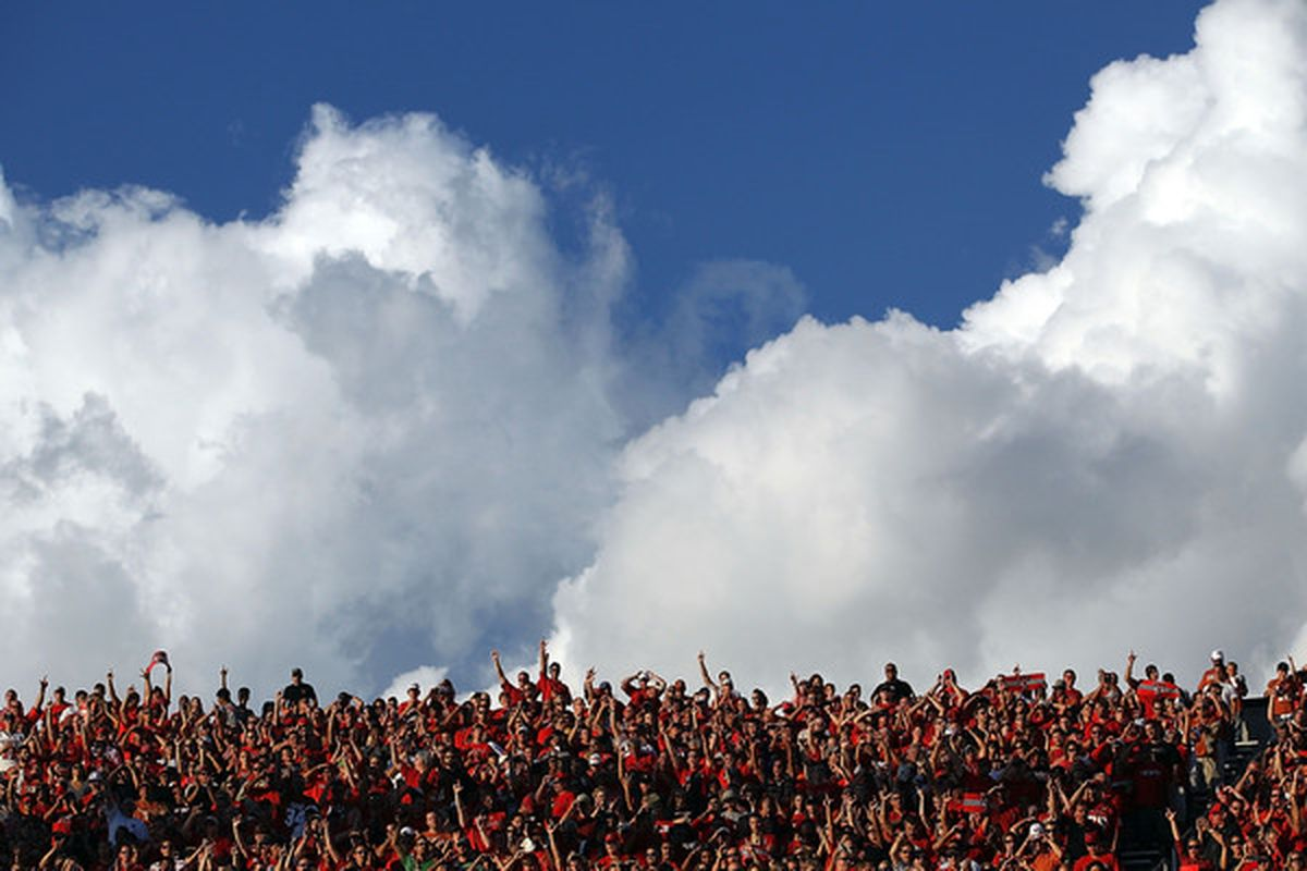 LUBBOCK TX - SEPTEMBER 18:  Fans of the Texas Tech Red Raiders cheer against the Texas Longhorns at Jones AT&T Stadium on September 18 2010 in Lubbock Texas.  (Photo by Ronald Martinez/Getty Images)