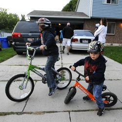 6-year-old Porter Burton, left, and 3-year-old Logan ride their bikes outside the Burton's home Sept. 25.