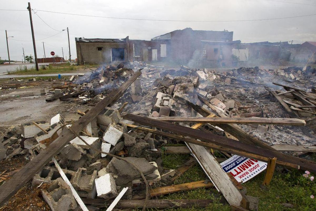 Tornado debris is burned in downtown Hackleburg, Ala., Monday, April 16, 2012. It was about 3:20 p.m. a year ago when the skies grew dark over the northwest Alabama town of Hackleburg and a tornado dropped from the sky. When it left, 18 people were dead.
