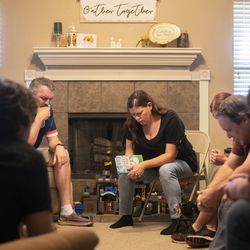 Katrina Hogue bows her head in prayer during an in home church service inside her home in Leander, Texas, on Sept. 6, 2020.