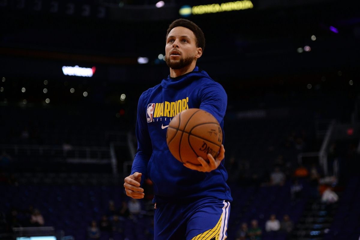 Golden State Warriors guard Stephen Curry warms up prior to the game against the Phoenix Suns at Talking Stick Resort Arena.
