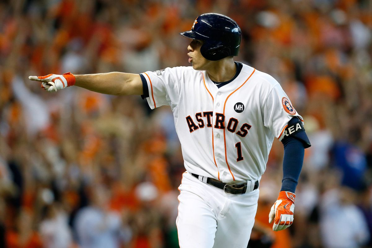 Carlos Correa celebrates after hitting his second home run of the game in the ALDS Game 4 against the eventual-champion Royals