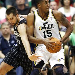 Utah Jazz forward Derrick Favors (15) spins away from Orlando's #33 Ryan Anderson as the Utah Jazz and the Orlando Magic play Saturday, April 21, 2012 in Energy Solutions arena.