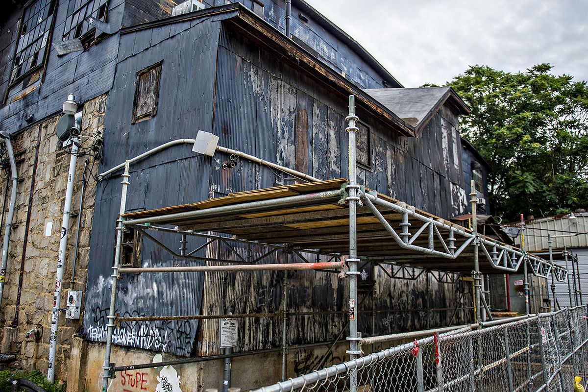 Scaffolding and fencing have been set up around the outside of The Masquerade off North Angier Avenue. This historically protected segment will house mixed uses near the large green field of Historic Fourth Ward Park's north end.