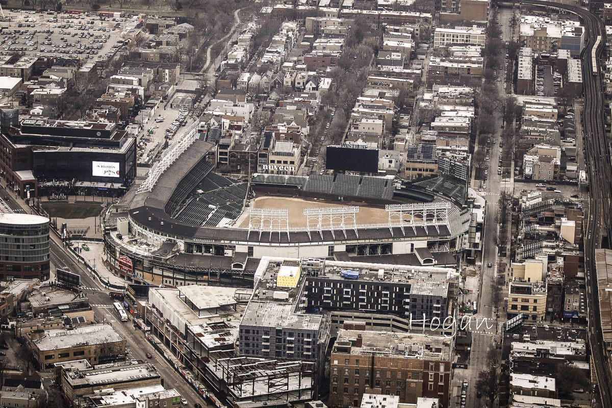 This aerial view shows Wrigley Field and construction of the Addison & Clark project as of March 29.   Lee Hogan / Sun-Times