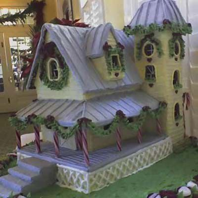 Gingerbread hotel with candy kane pillars.