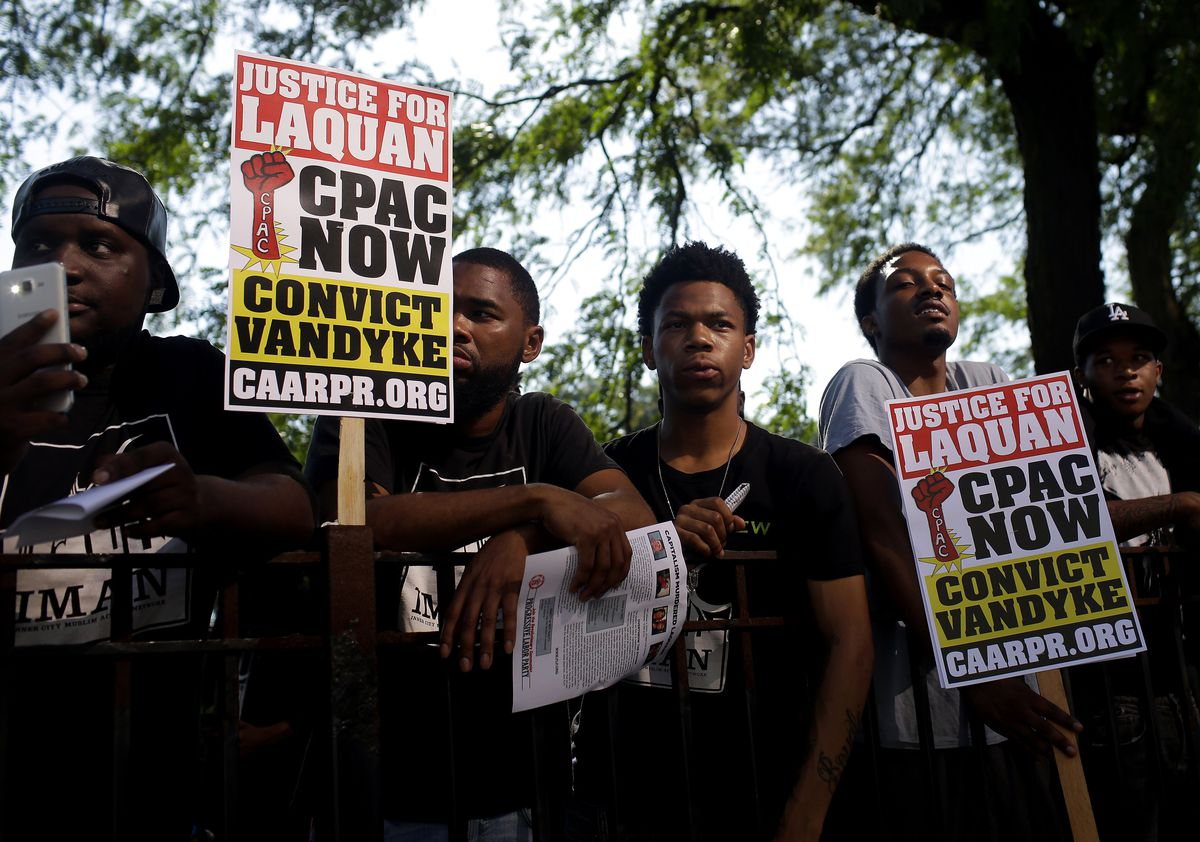 Demonstrators protest during the jury selection phase of Chicago Police Officer Jason Van Dyke's trial on September 5, 2018.