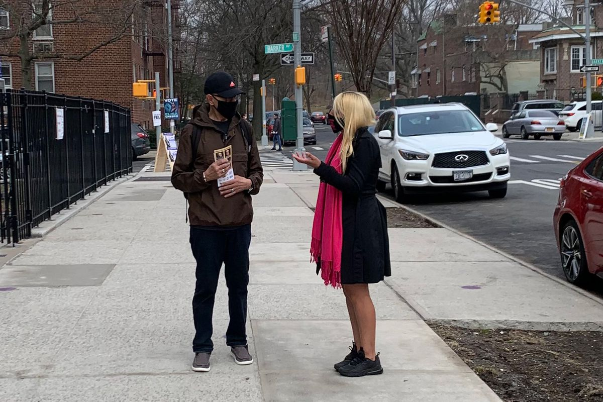 Bronx District 15 City Council candidate Ischia Bravo speaks with a voter on election day, March 23, 2021.
