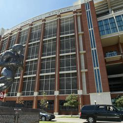 A statue of former Oklahoma running back Billy Sims is pictured outside the Gaylord Family Memorial Stadium in Norman, Okla. Thursday, Sept. 6, 2012. Oklahoma faces Florida A&M in their first home game of the NCAA college football season on Saturday.